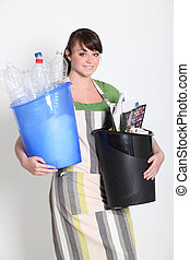 Brunette holding recyclable plastic