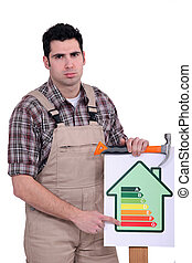 Carpenter nailing energy rating poster to wood