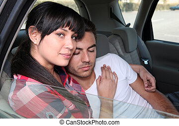 Boyfriend asleep in the back of the car