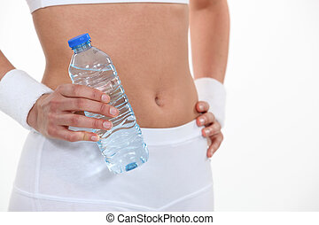 Sporty woman holding a bottle of water