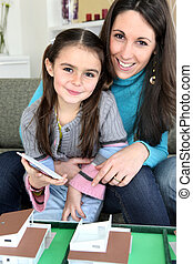 Mother and daughter looking at a new house plan