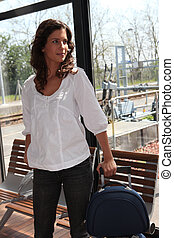 Woman in a train station