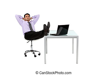 Businessman resting his feet on desk