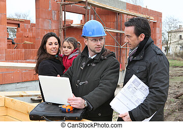 Family visiting site of new house