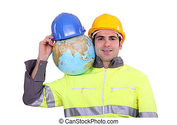 Worker with globe on his shoulder