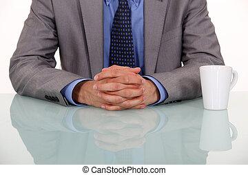 businessman crossing hands