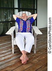 Senior man relaxing on a deck