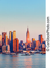Manhattan at sunset - Manhattan Skyline illuminated by...