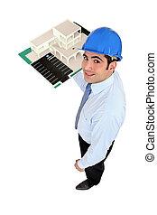 Man holding model housing development