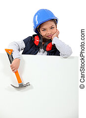 little girl dressed in construction worker