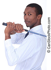 Businessman holding golf-club