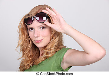 Strawberry blonde with big sunglasses
