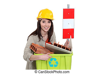 Tradeswoman taking out the recycling