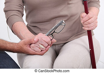 Man holding hands with an elderly lady