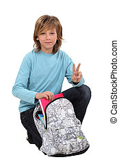 boy preparing his school bag