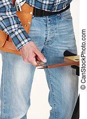 Tradesman using a vernier scale to measure a copper tube