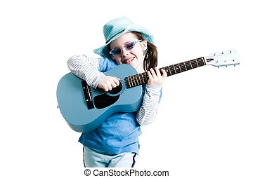 Young girl playing on a guitar while standing on a white...