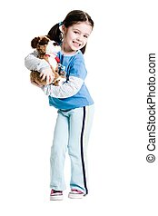 Young female child holding stuffed animal on a white...