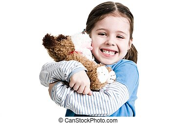 Young female child hugging stuffed animal on a white...