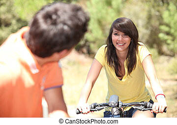 Smiling couple on a bicycle