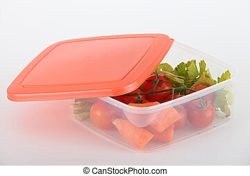 Raw vegetables in a plastic container