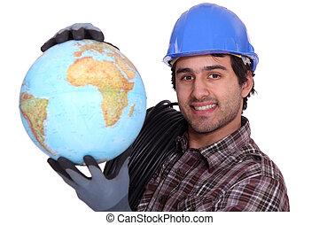 Manual worker holding globe