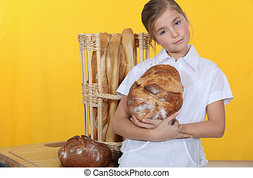 little girl baking bread