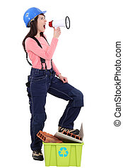 Female construction worker with a megaphone