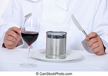 Chef sitting down to a canned dinner