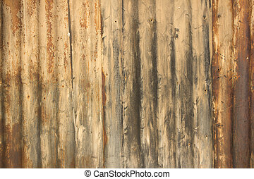 Rusty damaged corrugated metal surface texture - an old...