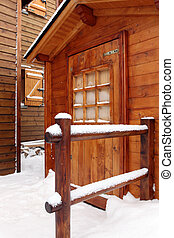 Snow covered holiday cabin
