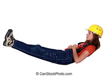 Female builder resting