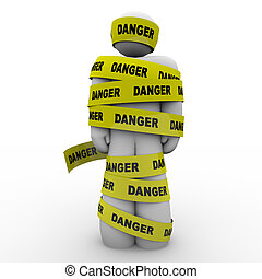 Person Wrapped in Yellow Danger Tape Warning Caution - A...