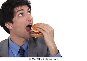 Man about to eat a burger