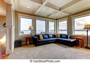 Living room wih many large windows and blue sofa. - Luxury...