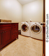 Laundry room with wood cabinets and new appliances. - Simple...