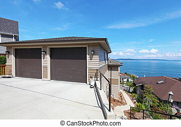 Two car garage on the hill with water view. - Luxury home on...