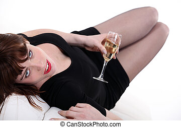 Woman drinking champagne alone