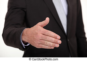 businessman stretching out hand to shake hands