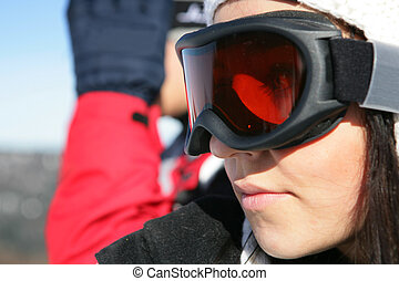Closeup of a woman wearing ski goggles