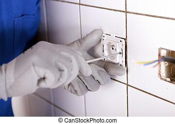 Repairing bathroom electrical socket