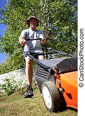 Senior with a lawnmower