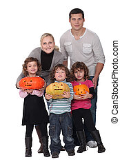 Family with Halloween jack-o'-lanterns
