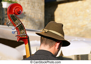 Man playing a colorful double bass