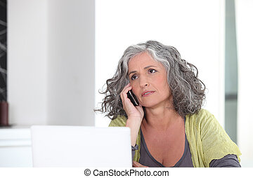 Grey-haired lady embracing the digital age