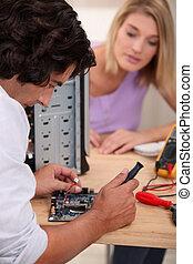 Computer repairing technician