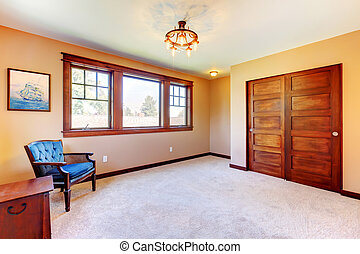Empty nice bedroom room with wood trim and blue chairs