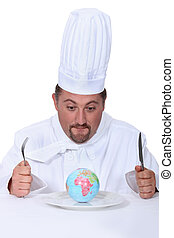 cook with globe on a plate