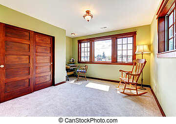 Nice empty bedroom with two windoows and wood closet doors.