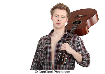 Man holding an acoustic guitar
